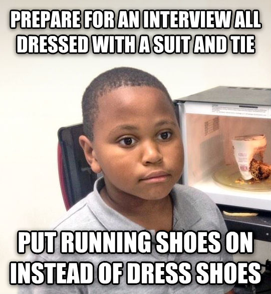 Minor Mistake Marvin prepare for an interview all dressed with a suit and tie put running shoes on instead of dress shoes , made with livememe meme generator