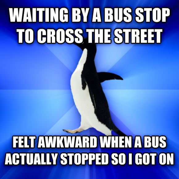 Socially Awkward Penguin waiting by a bus stop to cross the street felt awkward when a bus actually stopped so i got on  , made with livememe meme generator